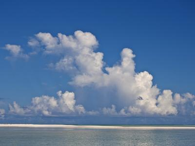 View of a White Beach, Ocean and Sky in the Seychelles-Michael Melford-Photographic Print