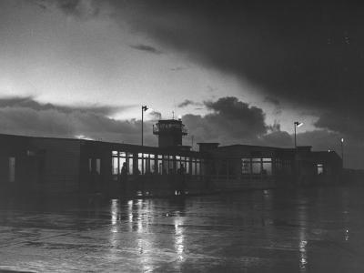 View of Airport and Runway at Dusk-Nat Farbman-Premium Photographic Print