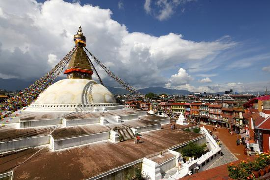 View Of Boudhanath Stupa From One The Many Rooftop Restaurants Surrounding It Photographic Print By Jill Schneider Art