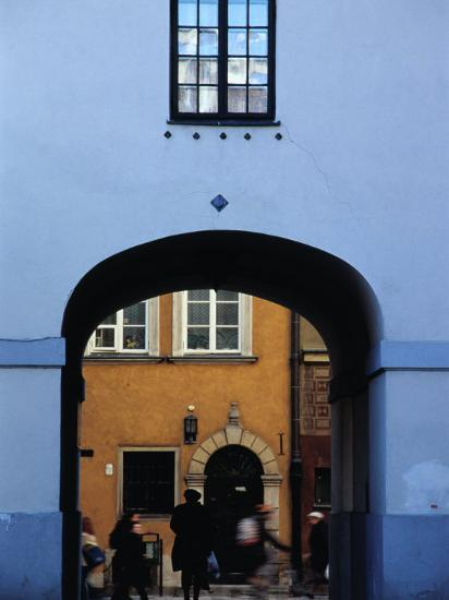 View of Busy Street through an Archway in Stare Miasto, Warsaw, Poland-Izzet Keribar-Photographic Print