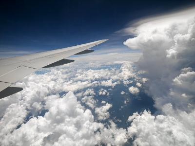 View of Clouds, Airplane Wing and the Sun from Window-xPacifica-Photographic Print