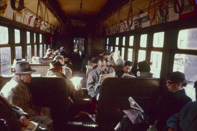 https://imgc.artprintimages.com/img/print/view-of-commuters-as-they-ride-in-a-car-on-the-third-avenue-train-new-york-new-york-1955_u-l-q130ta90.jpg?p=0