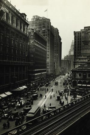 https://imgc.artprintimages.com/img/print/view-of-elevated-train-at-herald-square_u-l-pznu950.jpg?p=0