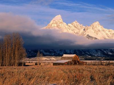 View of Historic Old Barn and Snow-Covered Teton Mountain Range-Jeff Foott-Photographic Print