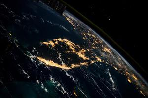 View of planet Earth from space showing night time over Cuba and Florida