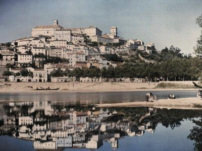 https://imgc.artprintimages.com/img/print/view-of-portugal-s-capital-coimbra-reflected-in-the-mondego_u-l-p89ao30.jpg?p=0