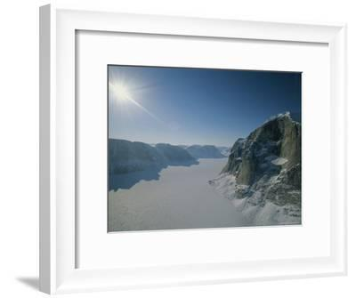 View of Remote, Snow-Covered Mountains Lining a Frozen Fjord on Canadas Baffin Island-Gordon Wiltsie-Framed Photographic Print