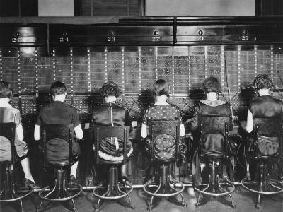 View of Row of Operators from Behind at Busy Switchboard at Telephone Company-Louis R. Bostwick-Photographic Print