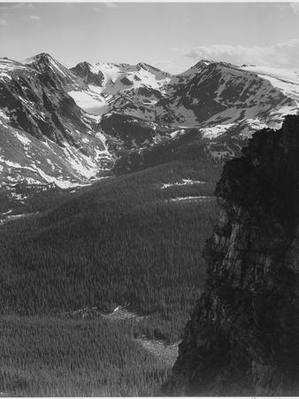 https://imgc.artprintimages.com/img/print/view-of-snow-capped-mt-timbered-area-below-in-rocky-mountain-national-park-colorado-1933-1942_u-l-q19qz9x0.jpg?p=0