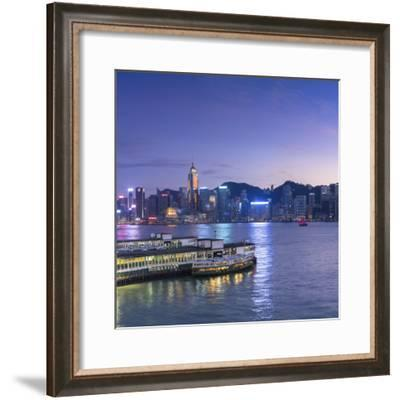 View of Star Ferry Terminal and Hong Kong Island skyline, Hong Kong, China-Ian Trower-Framed Photographic Print