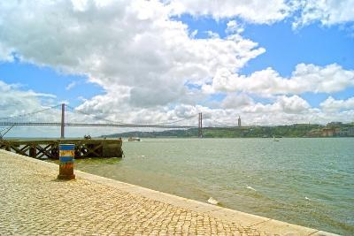 View of the 25 De Abril Bridge from the North Bank of Tejo River, Lisbon, Portugal--Photographic Print