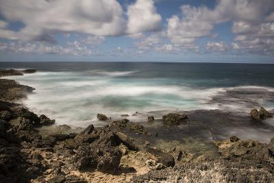 View of the Indian Ocean and Rocky Shore of a Tiny Offshore Island-Gabby Salazar-Photographic Print