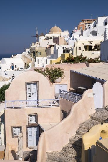 View of the Pastel Buildings and Steep Cliffs of the Picturesque Town of Oia, Santorini-Krista Rossow-Photographic Print