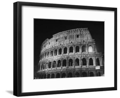 View of the Ruins of the Colosseum in the City of Rome-Carl Mydans-Framed Premium Photographic Print