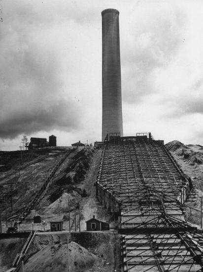 View of the World's Largest Smokestack Being Used at a Refinery  Photographic Print by Charles E  Steinheimer | Art com
