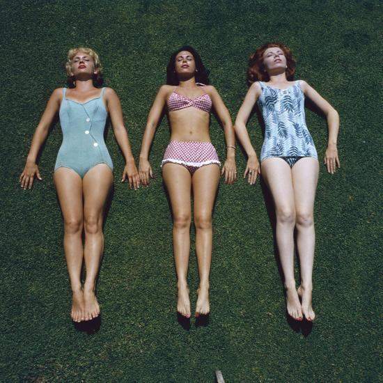 9932bd1d1aeca View of Three Unidentified Women in Bathing Suits as They Sunbath on Green  Grass, 1961 Photographic Print by Allan Grant   Art.com
