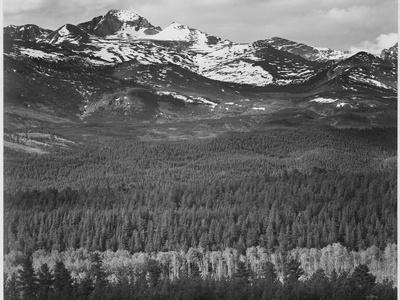 https://imgc.artprintimages.com/img/print/view-of-trees-and-snow-capped-mts-long-s-peak-from-road-rocky-mountain-np-colorado-1933-1942_u-l-q19qzcx0.jpg?p=0