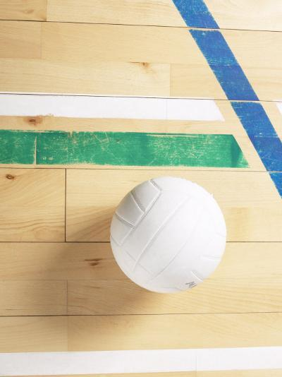 View of Volleyball on Wooden Gymnasium Floor--Photographic Print