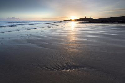 View over Embleton Beach at Sunrise Towards the Silhouetted Ruin of Dunstanburgh Castle-Lee Frost-Photographic Print
