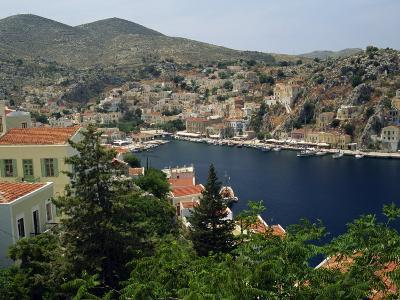 View over the Harbour and Town of Yialos on the Coast, Symi, Dodecanese Islands, Greece-Fraser Hall-Photographic Print