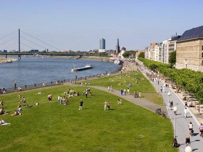 https://imgc.artprintimages.com/img/print/view-over-the-rheinuferpromenade-along-the-river-rhine-towards-the-old-city-north-rhine-westphalia_u-l-p1q7mm0.jpg?p=0