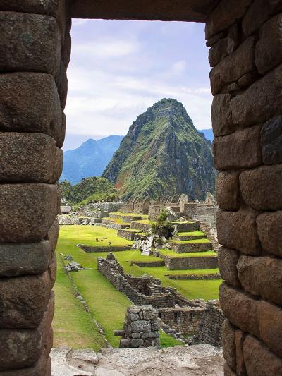 View Through Window of Ancient Lost City of Inca, Machu Picchu, Peru, South America with Llamas-Miva Stock-Photographic Print