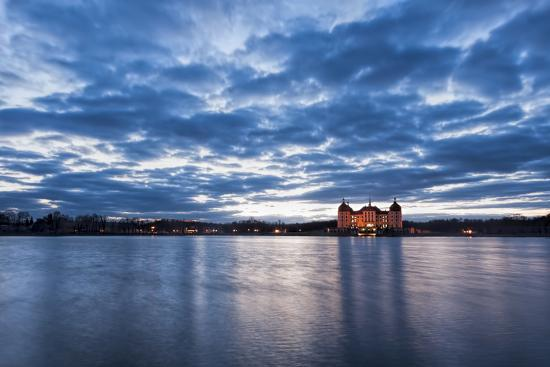 View to the illuminated castle Moritzburg, Saxony, in the early evening hours, blue hour with unusu-UtArt-Photographic Print