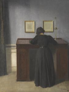 Ida Standing at a Desk by Vilhelm Hammershoi