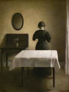 Interior with a back woman, 1898 by Vilhelm Hammershoi