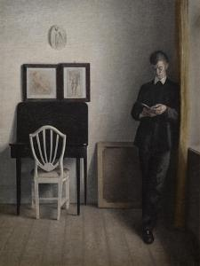 Interior with a young man reading, 1898 by Vilhelm Hammershoi