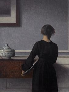 Interior with Young Woman from Behind by Vilhelm Hammershoi