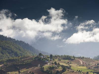 Village of Shingyer Against a Dramatic Backdrop of Mountains and Clouds, Phobjikha Valley, Bhutan, -Lee Frost-Photographic Print