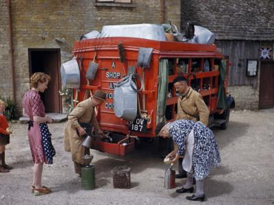 Villagers Buy Oil from Traveling Salesman by His Truck of Wares-Melville Grosvenor-Photographic Print