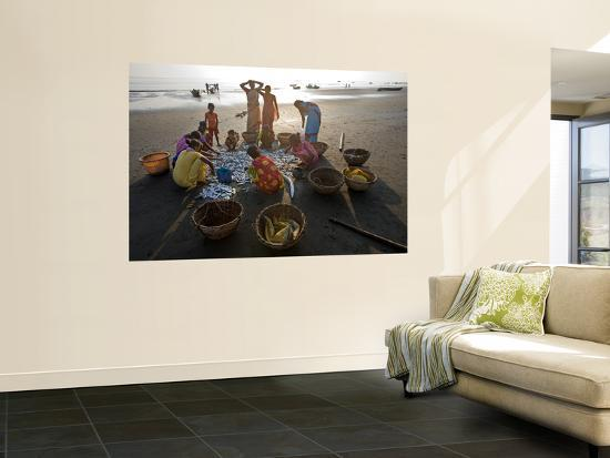 Villagers Looking at Fishing Catch on Beach-Johnny Haglund-Wall Mural