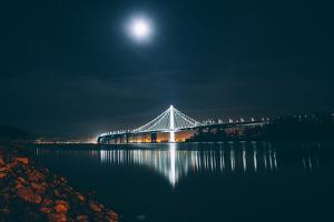 Oakland Bay Bridge by Moonlight and Reflection by Vincent James