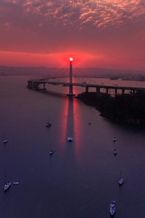 The Eye - Sunrise Alignment East Bay Bridge Boat Harbor Oakland Bay Area by Vincent James