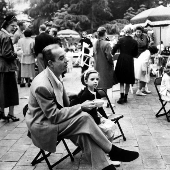 Vincente Minnelli with coffee sitting in chair with Daughter Liza at  Outdoor Children's Party Being Premium Photographic Print by J  R  Eyerman  |