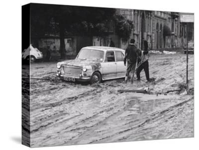 Automobiles Still Stuck in the Mud after the Flood in Florence