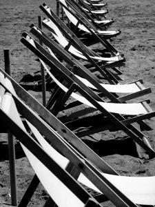 Lawn Chairs on a Beach by Vincenzo Balocchi