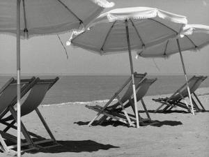 Sun Umbrellas and Lawn Chairs on a Beach by Vincenzo Balocchi