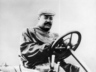Vincenzo Lancia at the Wheel of a Car