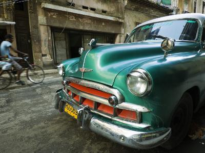 Vintage 1950's Car Parked on Street in Vedado District-Christian Aslund-Photographic Print