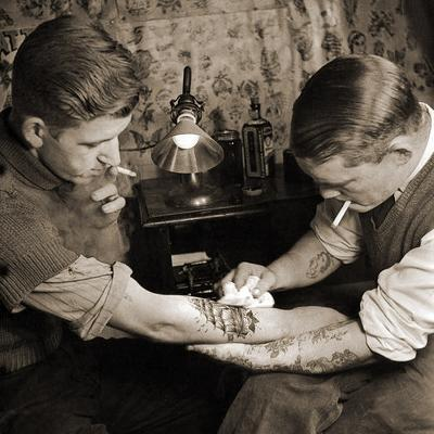 Vintage Shot of a Man Being Tattooed--Photographic Print