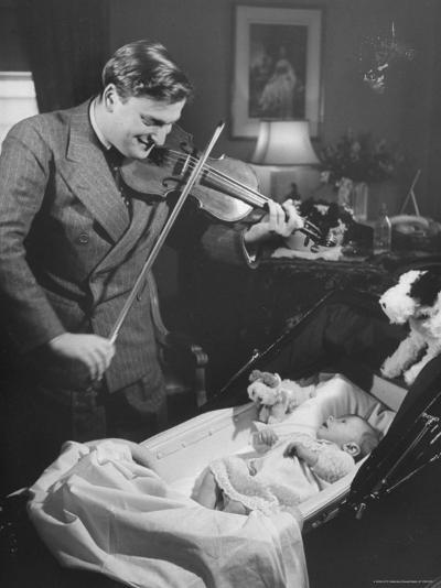 Violinist Yehudi Menuhin, Playing the Violin for His New Baby Daughter in Hotel Room-Hansel Mieth-Premium Photographic Print