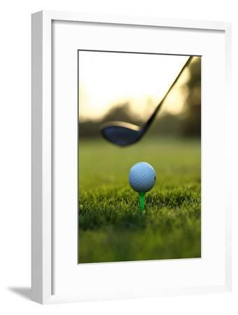 Close up of Golf Ball and Club on Course