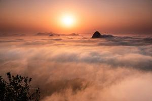 Beautiful Sunrise Landscape with Sugar Loaf Mountain Emerging from Low Clouds, Seen from Mirante Do by Vitor Marigo