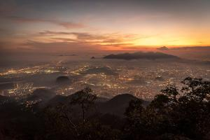 Beautiful View of City and Sunset Clouds Seen from Bico Do Papagaio Mountain in Tijuca Forest, Rio by Vitor Marigo