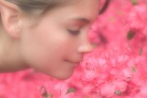 A Digitally Altered Photo Shows an Elf-Like Model Smelling Flowers by Vlad Kharitonov