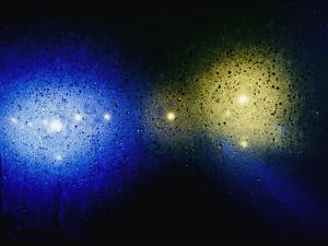 Lights Seen Through Rain-Spattered Glass by Vlad Kharitonov