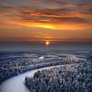 The Aerial View of Snow-Covered Winter Forest in Time Sundown on Christmas Eve. by Vladimir Melnikov